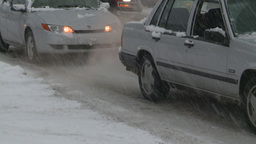 HD2008-12-7-14 snow traffic spinning tires Stock Video Footage