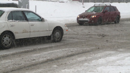 HD2008-12-7-18 snow traffic spinning tires Stock Video Footage