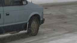HD2008-12-7-20 snow traffic spinning tires Stock Video Footage