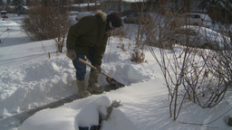 HD2008-12-7-30 snow shovel walk Stock Video Footage