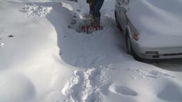 HD2008-12-7-34 TL snow shovel walk Stock Video Footage