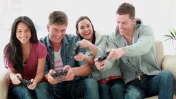 Friends playing video games while laughing Footage
