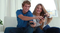 Smiling couple playing video games together Footage