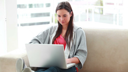 Smiling young woman using a laptop Stock Video Footage
