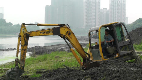 Riverbank Construction Sichuan China 6 machine Stock Video Footage