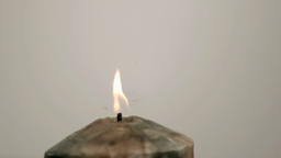 Drop falling in super slow motion on a candle Footage