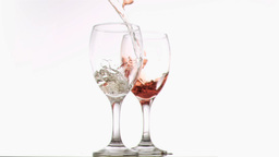 Wines filling glasses in super slow motion Footage