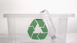 Plastic bottle falling in super slow motion Stock Video Footage