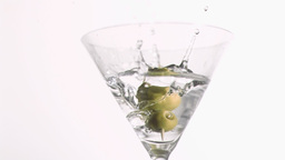 Olive skewer falling in super slow motion Footage