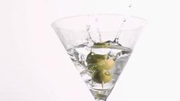 Olive skewer falling in super slow motion Footage