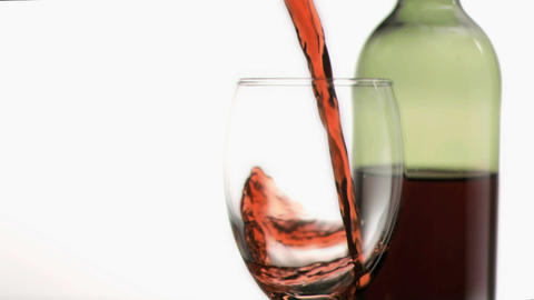 Red wine poured in super slow motion into a glass Footage