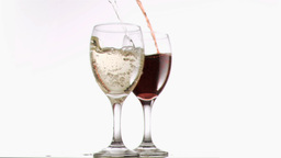 Glasses filled with wines in super slow motion Stock Video Footage