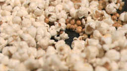 Popcorn cooking in super slow motion on a pan Footage