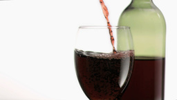 Red wine flowing in super slow motion into a glass Stock Video Footage