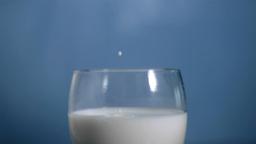 Milk droplets falling in super slow motion Live Action