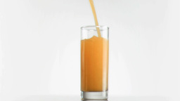 Mango juice filling in super slow motion a glass Stock Video Footage