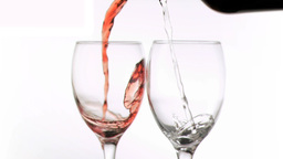 Wines being poured in super slow motion in glasses Footage