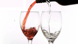 Wine poured in super slow motion in glasses Footage
