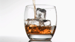 Scotch poured in super slow motion Stock Video Footage