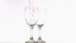 Water and wine poured in super slow motion Footage
