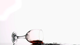 Red wine glass falling in super slow motion Stock Video Footage