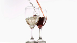 Red and white wine poured in super slow motion Footage