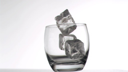 Ice cubes falling in super slow motion in a glass Stock Video Footage