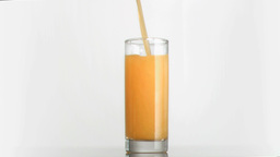 Orange juice poured in super slow motion Footage