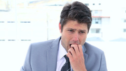 Businessman biting his nails Stock Video Footage