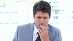 Businessman biting his nails Footage