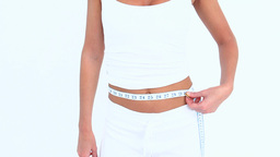 Woman measuring her waist Stock Video Footage