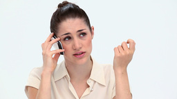 Worried woman phoning with a mobile phone Stock Video Footage