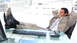Happy businessman the feet on his desk Stock Video Footage