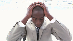 Black businessman holding his head in his hands Footage