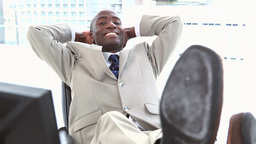 Black businessman the feet on his desk Stock Video Footage