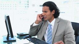 Businessman having trouble while phoning Live Action