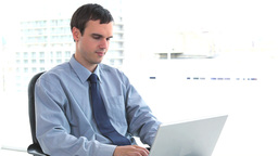 Businessman using a laptop at his office Stock Video Footage