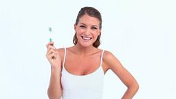 Woman brushing her teeth Footage