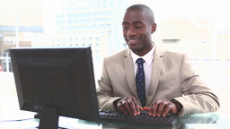 Black businessman typing on a keyboard Stock Video Footage