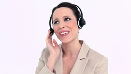 Woman in suit using a headset Stock Video Footage