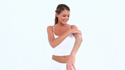 Woman applying moisturizer on her skin Footage