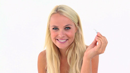 Blonde woman using tweezers Footage