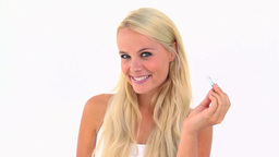 Blonde woman using tweezers Stock Video Footage