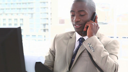 Businessman on the phone holding files Footage