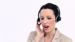 Young businesswoman speaking with a headset Footage