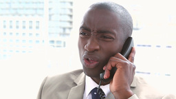 Businessman receiving a bad news by phone Footage
