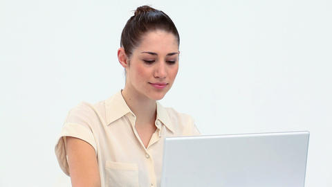 Young woman smiling while using a laptop Footage