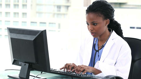 Female doctor using a computer Footage