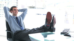 Young businessman resting in his office Footage