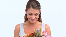 Happy woman smelling flowers Stock Video Footage
